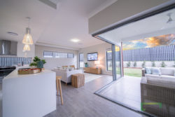 Kitchen, living and alfresco area of the Piha 303 a two-storey 5 bedroom home