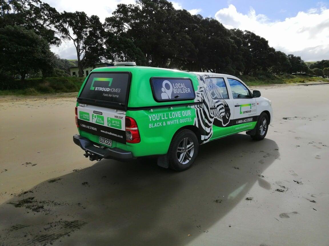 Stroud Homes branded ute on Auckland Beach